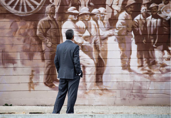 Man standing looking at Mural